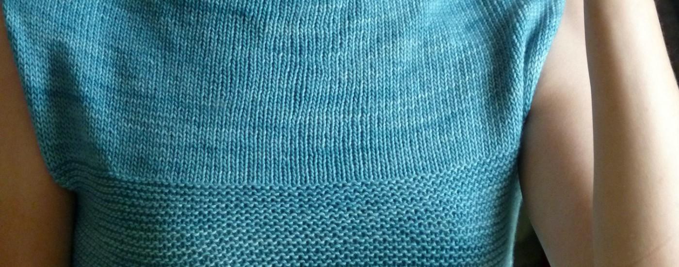 Le passage du jersey au point mousse qui démarre sur la poitrine